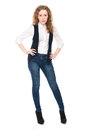 Portrait of young business girl with curly hair in jeans Royalty Free Stock Photo