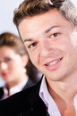 Portrait of young business man with his colleague at the back Royalty Free Stock Photo