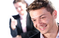 Portrait of young business man with his colleague at the back Royalty Free Stock Image