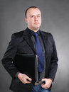 Portrait of a  young business man standing with laptop Royalty Free Stock Photo