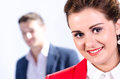 Portrait of young business woman with her colleague at the back Stock Photos