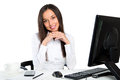 Portrait of a young business woman using computer at office in Royalty Free Stock Image