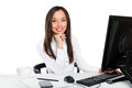 Portrait of a young business woman using computer at office in Royalty Free Stock Images