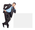 Portrait of young businessman and blank sign board Royalty Free Stock Photo