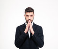 Portrait of a young businessman praying Royalty Free Stock Photo