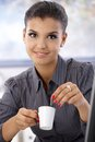 Portrait of young businesswoman with coffee attractive drinking smiling Royalty Free Stock Photography