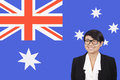 Portrait of young businesswoman smiling over australian flag Royalty Free Stock Images