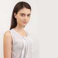 Portrait of young calm beautiful brunette woman posing for model tests against white background fashionable Stock Image