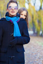 Portrait of young caucasian couple standing together in park area and playing Stock Image
