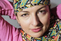 Portrait of a young caucasian positive woman with headscarf Stock Image
