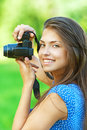 Portrait young charming woman camera smiling background summer green park Royalty Free Stock Images