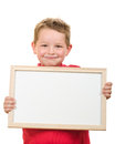 Portrait of young child boy holding blank sign with room for your copy isolated on white Royalty Free Stock Image
