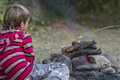 Portrait of young child boy looking at fire outdoor Stock Photos