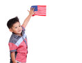 Portrait of a young child holding the American flag isolated on Royalty Free Stock Photo