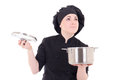 Portrait of young cook woman in black uniform holding pan isolat Royalty Free Stock Photo