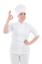 Portrait of young cook woman showing ok sign isolated on white Stock Images
