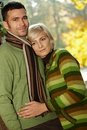 Portrait of young couple in autumn park Royalty Free Stock Photos
