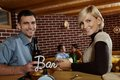 Portrait of young couple in bar Stock Photography