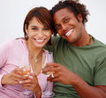 Portrait of a young couple drinking champagne Stock Photo