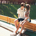 Portrait of young couple embracing outdoors in sunny summer day Royalty Free Stock Photos
