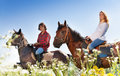 Portrait of young couple horseback riding Royalty Free Stock Photo