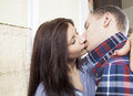 Portrait of a young couple kissing Stock Photo