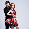 Portrait of young couple in love posing at studio dressed classic clothes Royalty Free Stock Photography