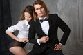 Portrait of young couple in love posing at studio dressed in classic clothes beauty and fashion Royalty Free Stock Photo