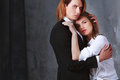 Portrait of young couple in love posing at studio dressed in classic clothes sexy passion beautiful men and women closeup shot Royalty Free Stock Photos