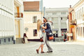 Portrait of young couple in love standing in old town outdoors Royalty Free Stock Photos