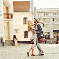 Portrait of young couple in love standing in old town outdoors Royalty Free Stock Photography