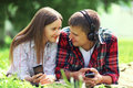 Portrait of young couple lying relaxing on the grass together Royalty Free Stock Photo