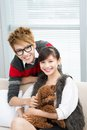Portrait young couple sitting sofa poodle Stock Image