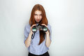 Portrait of young cute redhead woman wearing blue striped shirt smiling with happiness and joy while posing with binoculars again