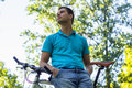 Portrait of a young cyclist taking a break outdoors Stock Images
