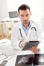 Portrait of a young doctor using tablet at work view Royalty Free Stock Photography