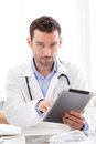 Portrait of a young doctor using tablet at work view Stock Image
