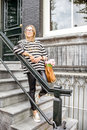 Woman on the stairs near luxury house Royalty Free Stock Photo