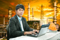 Portrait young engineering  man sittin and working on laptop com Royalty Free Stock Photo