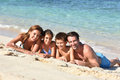 Portrait of young family lying on the beach laying a sandy Stock Photo