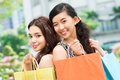 Portrait young female couple shopping bags outdoors Stock Photography