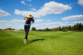 Portrait of young female golf player back view a male Stock Image