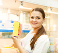 Portrait of young female pharmacist showing medicine box Royalty Free Stock Photo