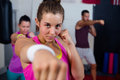 Portrait of young female practicing boxing against flags Royalty Free Stock Photo