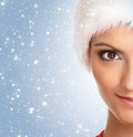 Portrait of a young and fit woman in a fur hat Royalty Free Stock Image