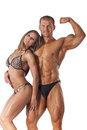 Portrait of young fitness couple on white background Stock Photos