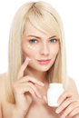Portrait young fresh beautiful healthy woman applying cream her face over white background Royalty Free Stock Photos