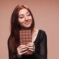 Portrait young girl with the big chocolate of Royalty Free Stock Photography