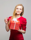 Portrait of a young girl with a Christmas gift box