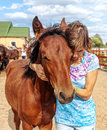 Portrait of young girl with a foal on the farm Royalty Free Stock Photo